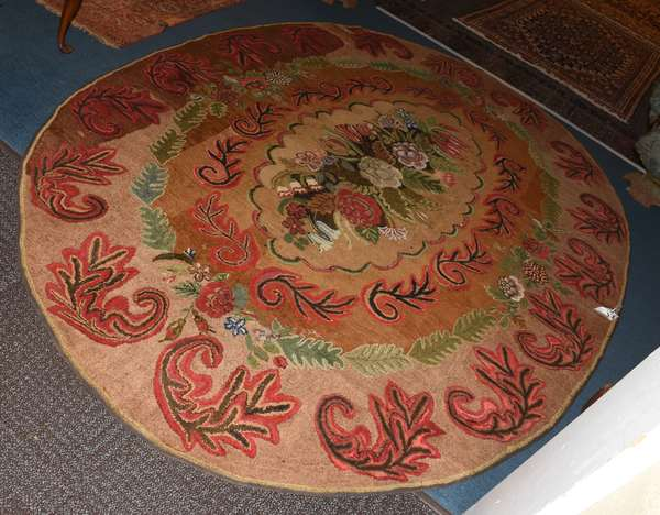 Oval 19th C. floral hooked rug, unusual large size, 6'7