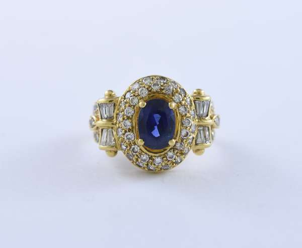Marked 18k yellow gold diamond and sapphire ring, a beautiful blue sapphire approximately 1.5 carats with approx. 1.2 ctw diamonds, 6.8 grams, size 6.5