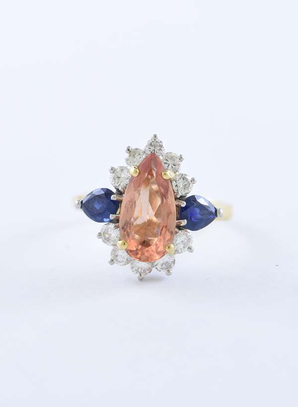 Fine Imperial topaz sapphire and diamond ring 1.75 ct pear shaped Imperial topaz, .50 ctw sapphires and .65 ctw diamonds set in 18k yellow gold, size 7