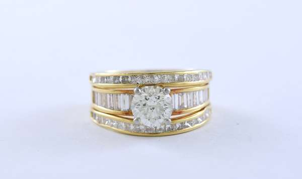 Approx. 1.25 ct diamond ring with approx. 1.5 ctw other diamonds