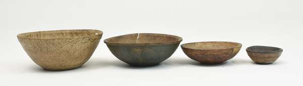 Four early wooden bowls: two burl wood bowls, one bowl in old blue paint, and small turned bowl, 4.5