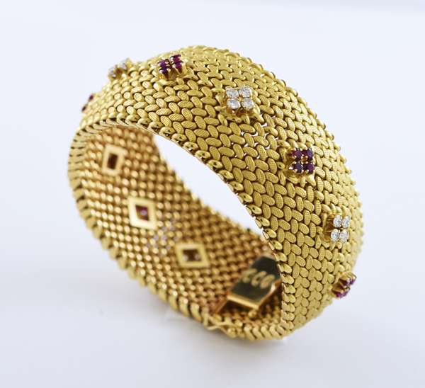 18k yellow gold signed Cartier bracelet set with approximately 3.0 ct total weight of diamonds and rubies, 1 1/8