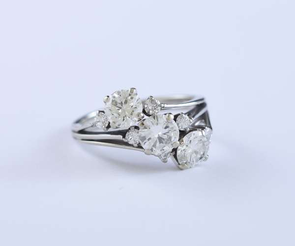 Stamped 18k white gold three stone diamond ring set with approximately 2.41 ct total weight round brilliant cut diamonds, size 7.25, 5.5 grams