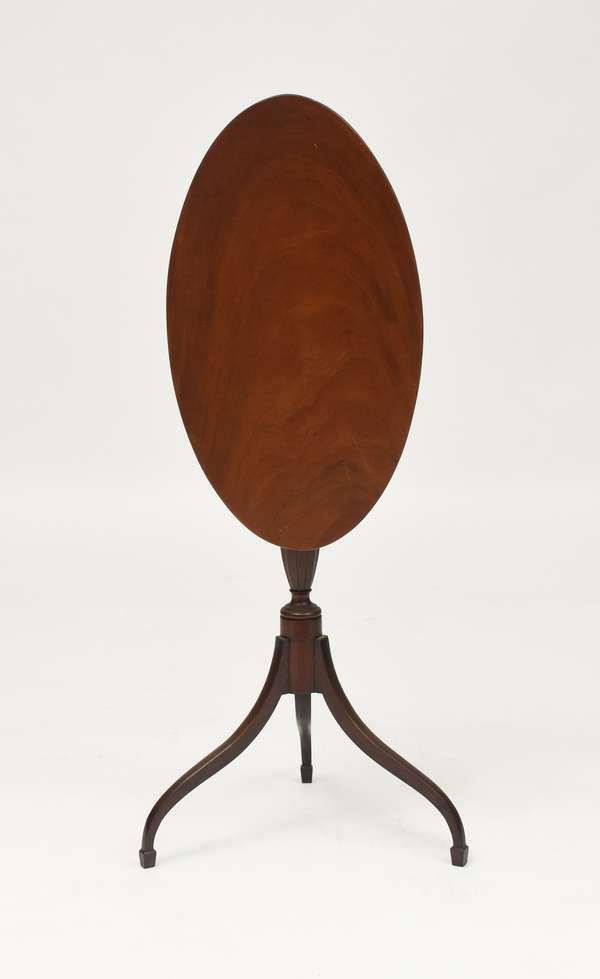 Federal carved mahogany tilt candlestand, spade feet with carved urn pedestal, oval tilt top, 28