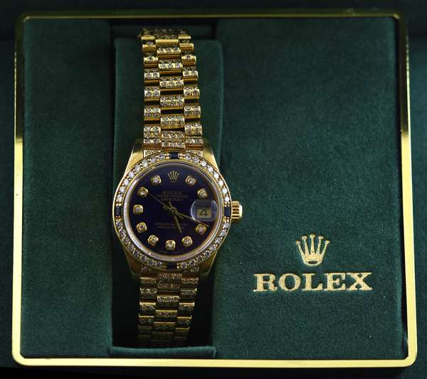 18k yellow gold and diamond ladies Oyster Perpetual Datejust Rolex 26 mm watch with diamond and sapphire accented bezel complete with diamond encrusted President bracelet set with approx. 2.5 ct total weight single cut diamonds, cobalt blue diamond numeral dial, bezel and dial approx. 1.0 ct total weight (including blue sapphires), 6.5