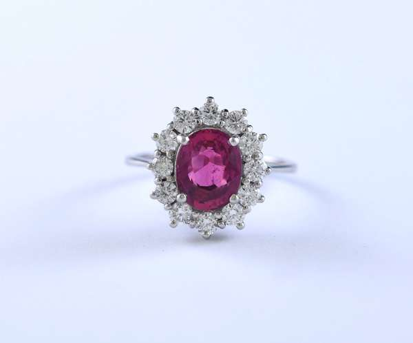18k white gold GIA certified ruby and diamond ring set with 2.4 ct ruby accented by approx. .75 ct total weight round brilliant cut diamonds, size 6.75, 6.3 grams, ruby GIA report #6295597684