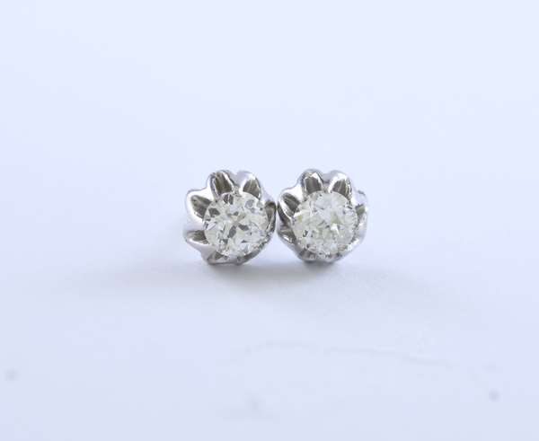 Pair of diamond stud earrings with threaded posts, approximately 1.25 ctw set in tested platinum buttercup settings, 3.0 grams (14k screw nuts