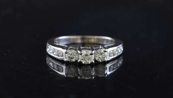 Ref 21: 14k white gold diamond band, three large diamonds with eight smaller diamond, approx. 1 ctw, size 6.5 (5-92)