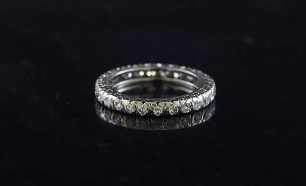 Ref 25: 14k white gold and diamond eternity band approx. 1 ctw diamonds (5-96)