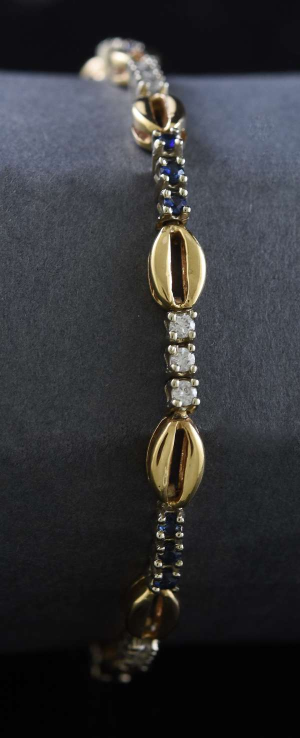Ref 27: 14k white and yellow gold bracelet set with diamonds and sapphires, 7