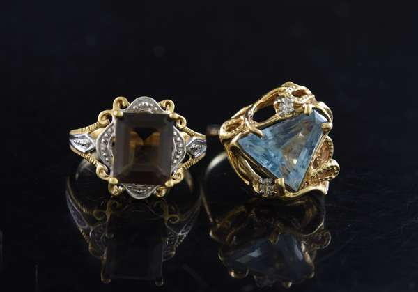 Ref 35: (2) 14k gold rings, a triangular cut aqua with diamond and smokey topaz (5-107)