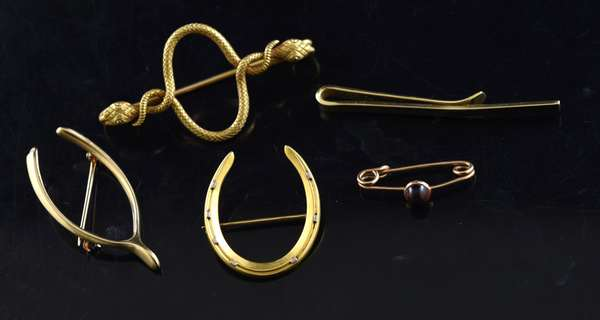Ref 40: Lot of four 14k gold pins, and a 14k gold tie clip, 20.2 grams (96-155)