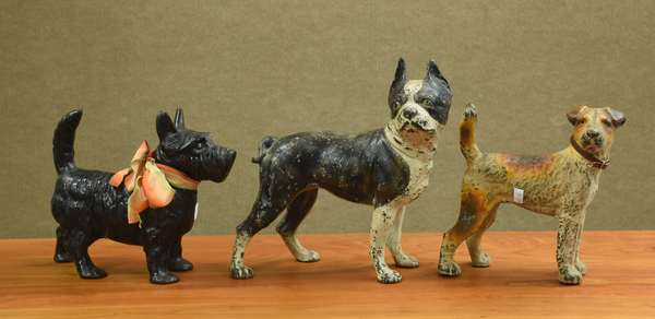 Three dog doorstops (683-45)