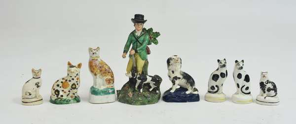 Collection of 18th/19th C. pearlware and early Staffordshire figures, dogs, cats and hunter with dog, 8 pieces, 2.75