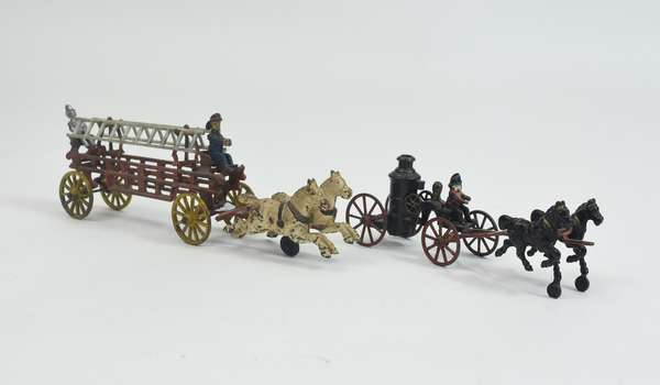 Two painted cast iron horse-drawn fire truck toys, ladder truck, 15