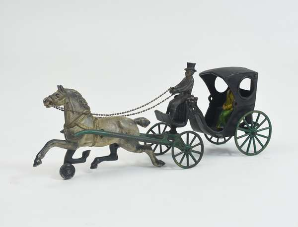 Painted cast iron horse-drawn carriage toy, 15
