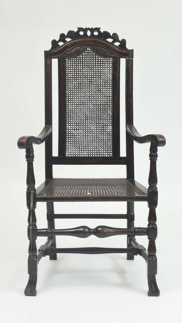 18th C. Queen Anne Spanish foot armchair with carved crest and caned seats