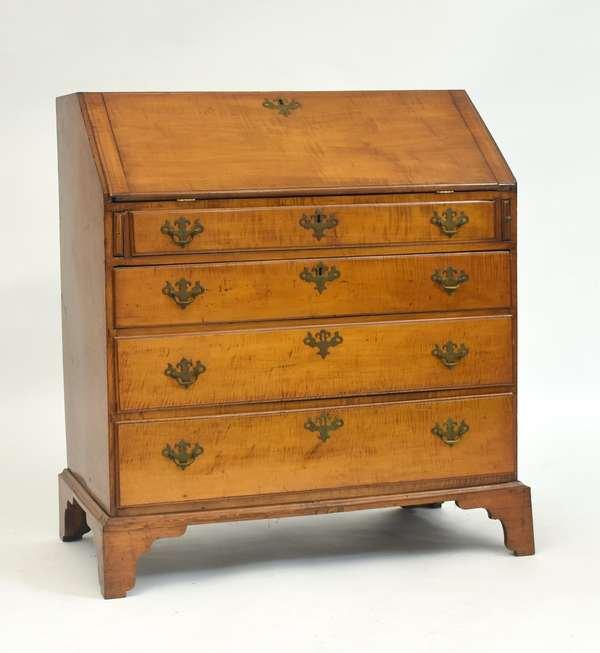 Fine Chippendale curly maple slant lid desk on original dovetailed bracket base, 35.5