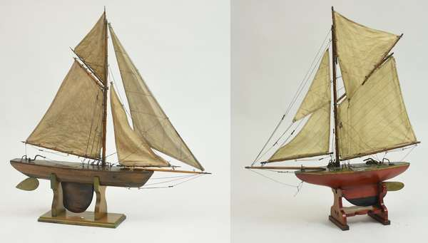 Two antique pond boats on stands, brass rudder and hardware, 33.5
