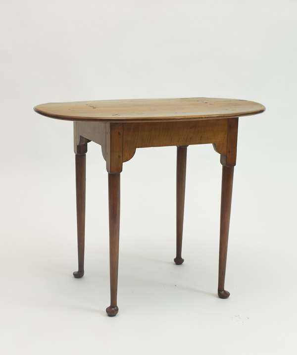 18th C. Rhode Island Queen Anne maple tea table with delicate legs ending in pad feet, apron with some figuring, 34