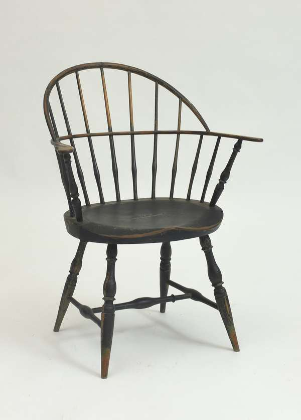 18th C. Windsor sack back armchair in old black over early green paint, good proportions, 17.25