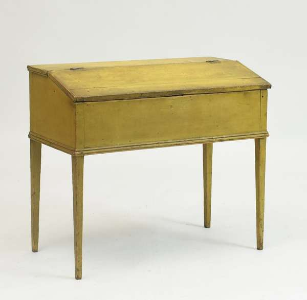 Country early 19th C. Federal standing desk in old mustard paint, delicate tapered legs with sectioned interior, 31