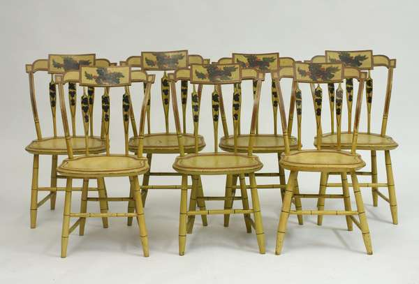 Set of seven 19th c. yellow paint decorated country arrow back Windsor chairs, with grape and fruit motifs, 17
