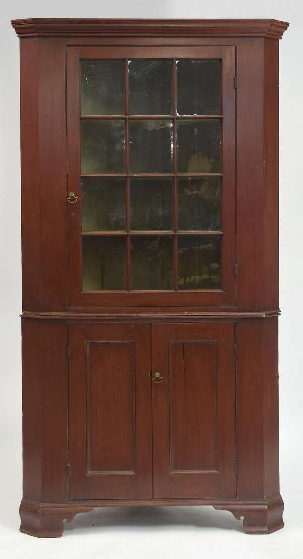 Fine late 18th C. Chippendale two-part corner cupboard in red paint on ogee feet with twelve-pane original glass top and two doors below, 90