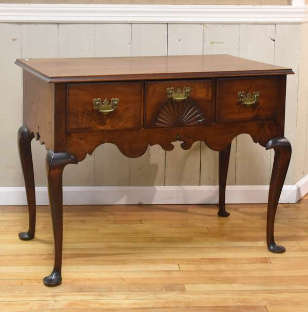 Queen Anne maple server/lowboy, with three drawers including fan carving and shaped apron, 37