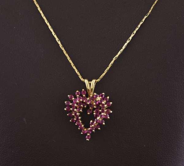 Ref 16 - 14k gold ruby heart pendant on chain 3.9 grams (96-17)