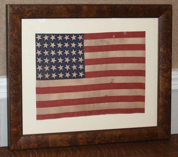 Framed small American flag, 42 star, 12