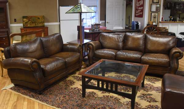 Modern brown studded leather sofa with matching love seat, 84