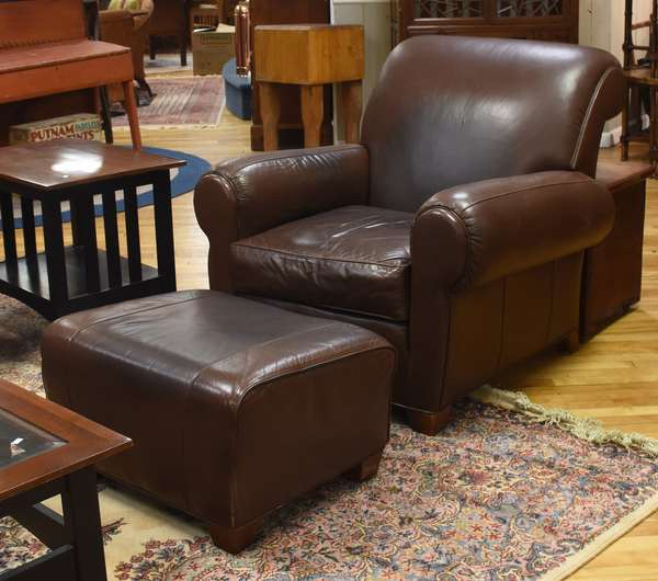 Brown leather club chair with ottoman by Leathercraft, Inc., 39