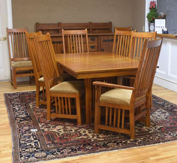 Mission oak dining table and eight matching chairs with upholstered seats, two armchairs, by Thomasville, table 74