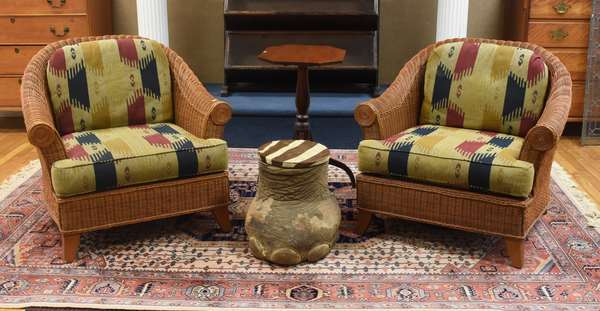 Two wicker armchairs with Western-style upholstery
