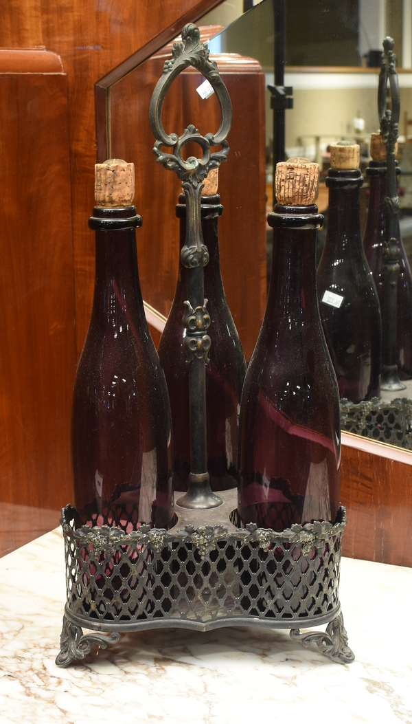"Victorian three-bottle tantalus with silver plated holder and period amethyst bottles, bottles 13""H, overall 19""H(76-232)"