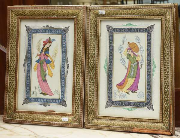 "Two well-painted Persian paintings on ivory, maidens, with border painted on paper, in elaboratly painted frames, size of ivory: 8"" x 3.75"", overall size with frames: 14"
