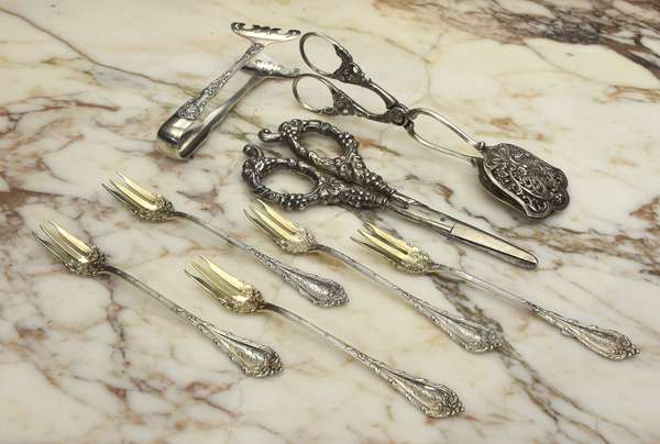 Lot of silver: five sterling shellfish forks, sterling handled grape shears, sterling asparagus tongs and 800 silver ornate tongs (76-241)