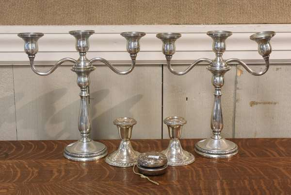 Two pairs of sterling candlesticks with a sterling Gorham yo-yo	(259-4)