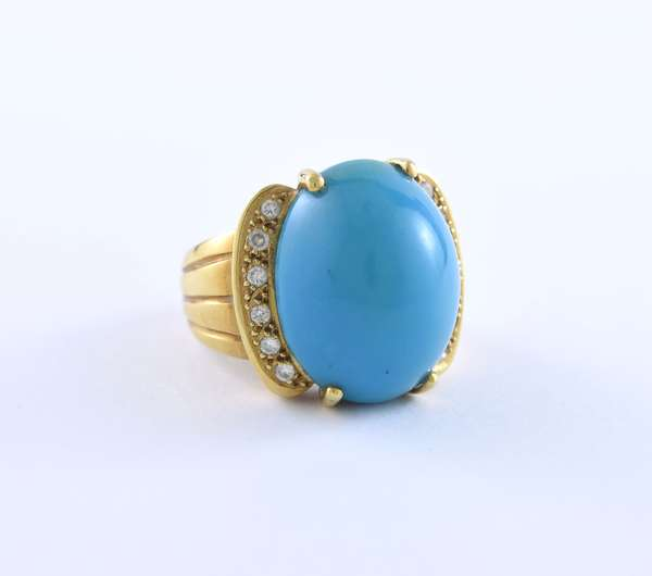 Tested 18k yellow gold ring set with turquoise cabochon, 20 x 16 mm accented by .30 ctw round brilliant cut diamonds, size 7.5, 15.4 grams