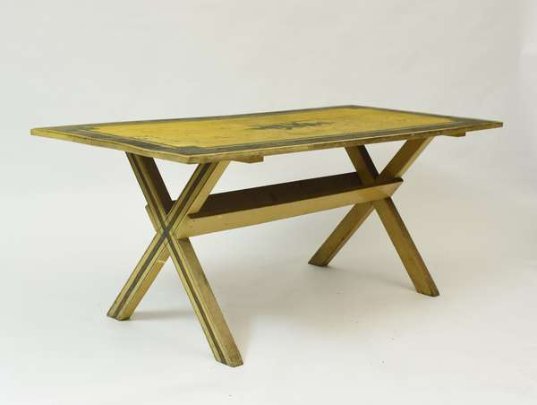 Early 19th C. yellow and black paint decorated saw buck table, 29.5