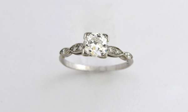 Platinum engagement ring set with approx. .86 ct old European cut diamond accented by approx. .07 ctw single cut diamonds, 2.8 grams, size 6.25
