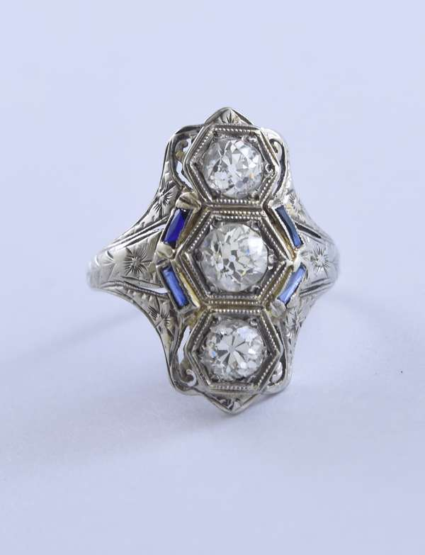 18k white gold hand engraved diamond ring set with three old European cut diamonds, approx. 1.50 ctw, accented by four blue sapphire baguettes (poss. syn.), size 6.5, 3.9 grams