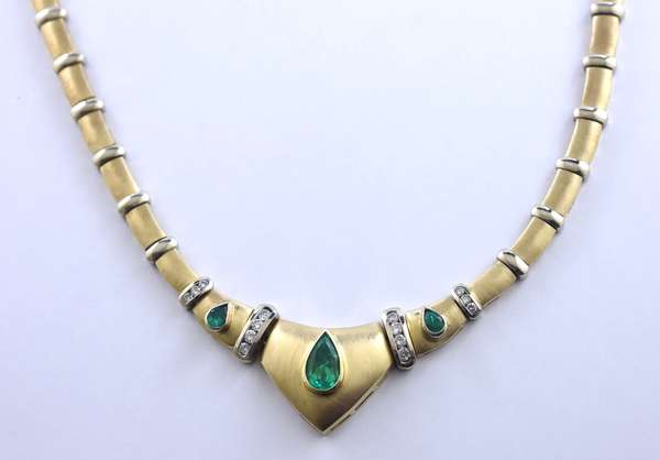 """14k yellow gold necklace with matte finish and white gold bar accents, set with approx. 2.15 ct pear shape emerald center and .60 ctw emerald accented by approx. .75 ctw round brilliant cut diamonds, 16""""L., 58.9 grams"""