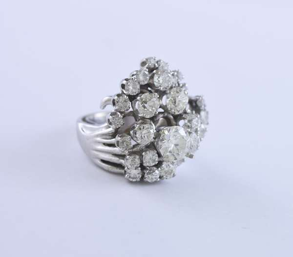 Tested platinum and diamond cocktail ring set with 1.12 ct (actual weight) old European cut diamond accented by approx. 3.50 ctw old European and transitional cut diamonds, approx. size 6, 16.5 grams