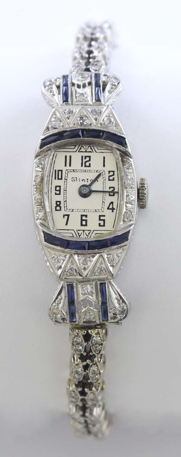 Art Deco platinum diamond and sapphire (poss. synthetic) Winton wrist watch set with approx. 1.25 ctw single cut diamonds, 8