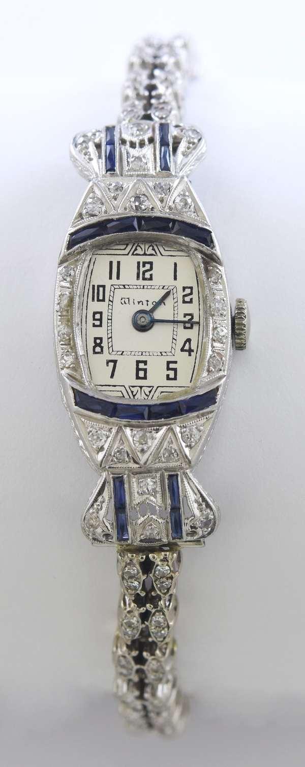 "Art Deco platinum diamond and sapphire (poss. synthetic) Winton wrist watch set with approx. 1.25 ctw single cut diamonds, 8""L., 29.4 grams"