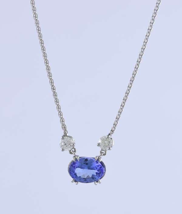 Platinum tanzanite and diamond station necklace set with oval tanzanite approx. 1.30 ct and .30 ctw round brilliant cut diamonds, 16