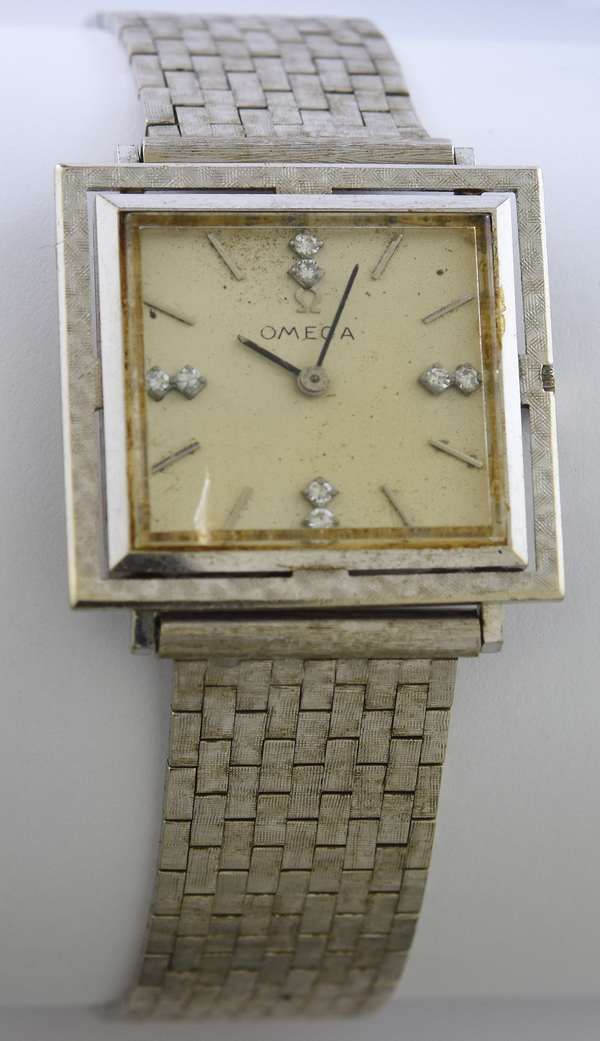14k white gold Omega watch with square face accented by diamonds, monogram R.E.L. with brick link bracelet, 8