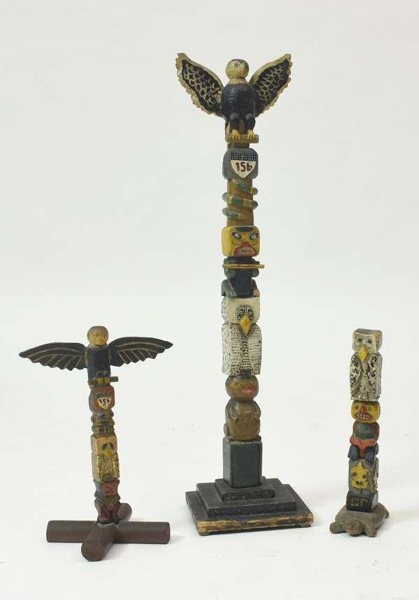 "Three carved Folk Art Boy Scout totem poles, troop 156, 13"" to 32""H."